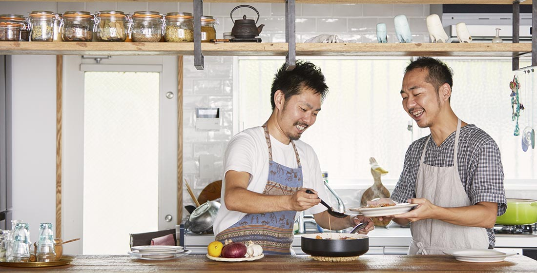 Two men cooking together in a kitchen