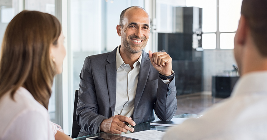 Businessman smiling, talking with clients