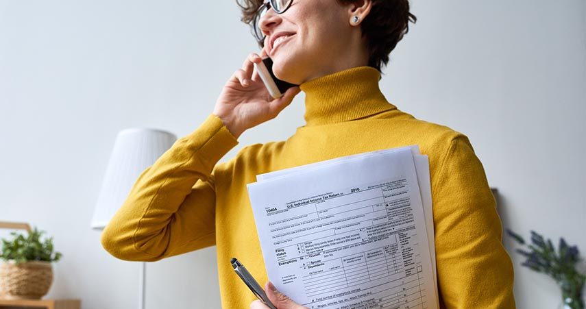 Woman smiling with IRS papers