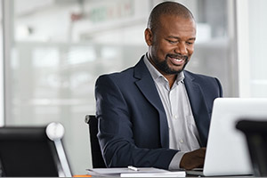 Office worker sitting in front of laptop
