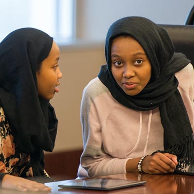 Focus on community - two school-aged girls sitting together