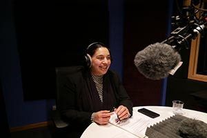 Simone Ahuja in an audio recording booth