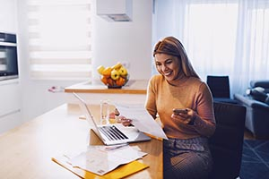 women smiling at phone drinking coffee