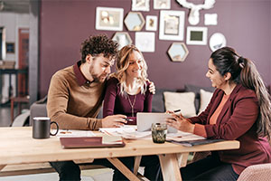 Couple consulting with a loan specialist