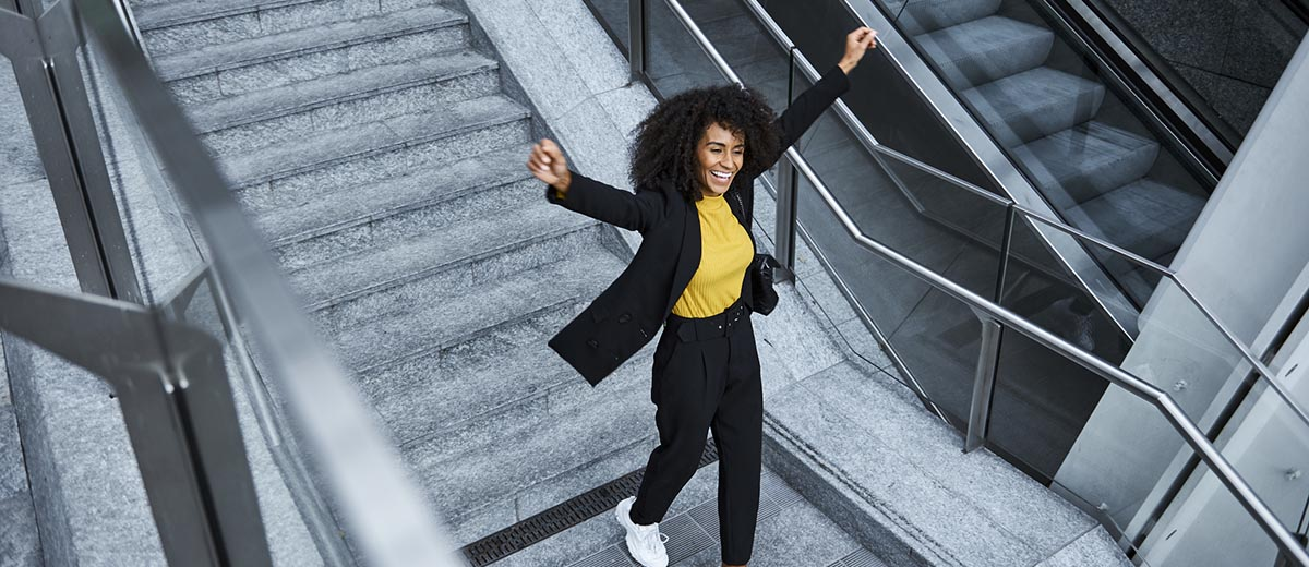 Excited woman walking down stairs
